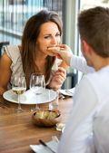 Man Feeding Bread to His Girlfriend — Stock Photo