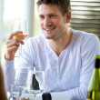 Handsome Guy Holding a Glass of Wine — Stock Photo