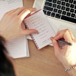 Writing In Notebook On Laptop — Stock Photo