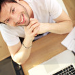 Overhead View Smiling Man At Laptop - Stock Photo