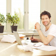 Confident Smiling Man Working At Desk - Foto de Stock  