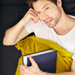 Tired Student With Blanket And Textbook - Stock Photo