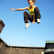 Stock Photo: Traceur Demonstrating Parkour