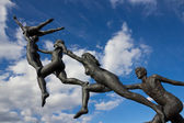 Statues jumping — Stock Photo