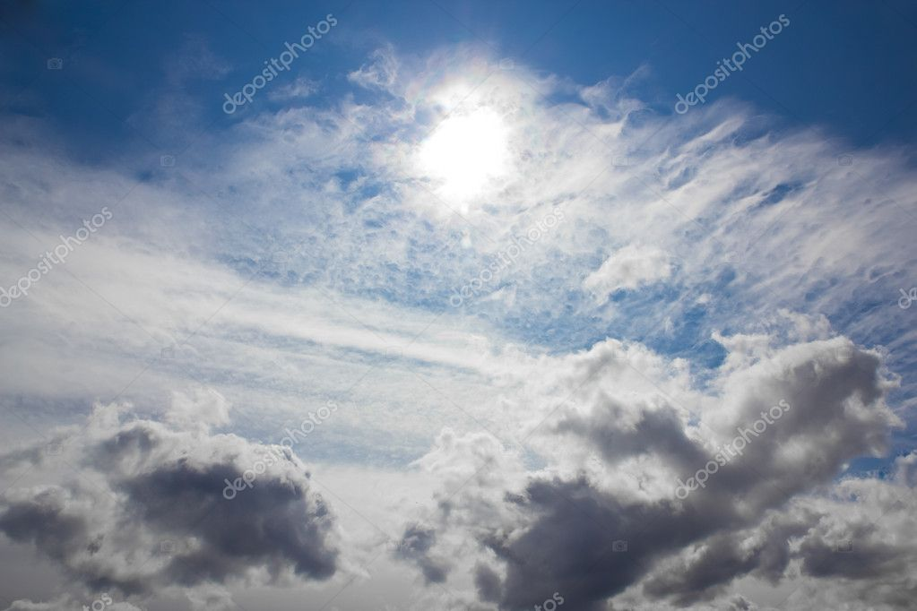 A picture of the sky, with different type of clouds and the sun — Stock Photo #10695098