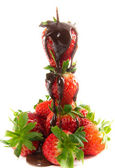 Melted chocolate on strawberry tower — Stock Photo