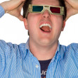 Frustrated man watching a 3d movie — Stock Photo