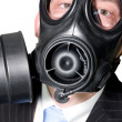 Man with gasmask and suit — Stock Photo