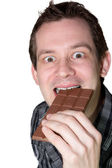 Man eating chocolaet — Stock Photo