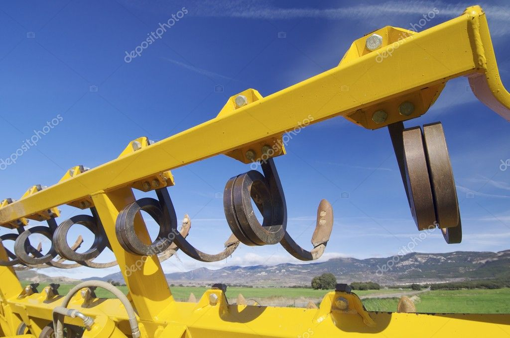 Tool for agricultural tillage yellow sky blue  Stock Photo #8562439