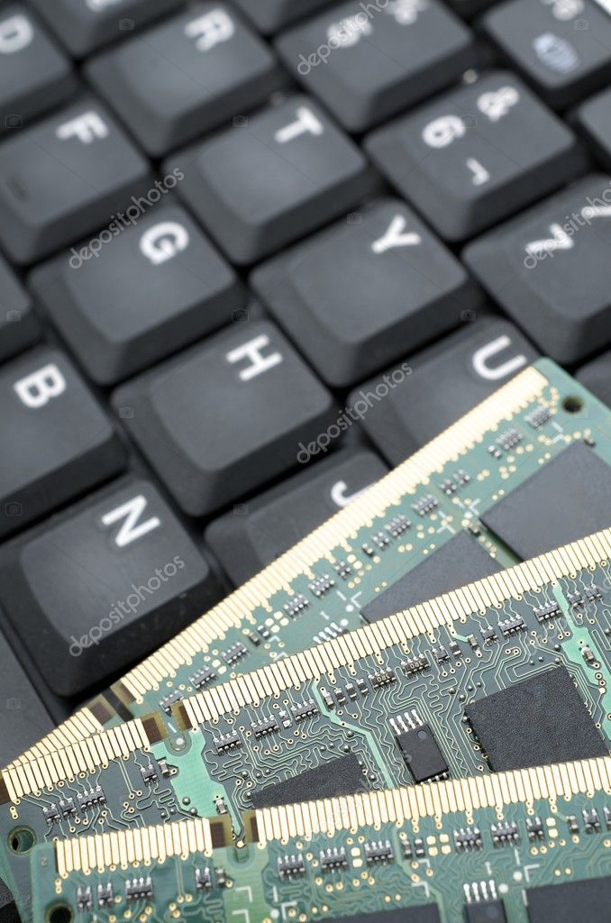 Closeup of a  keyboard and a group of electronic circuits — Stock Photo #9138441