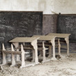 Abandoned desks - Stock Photo