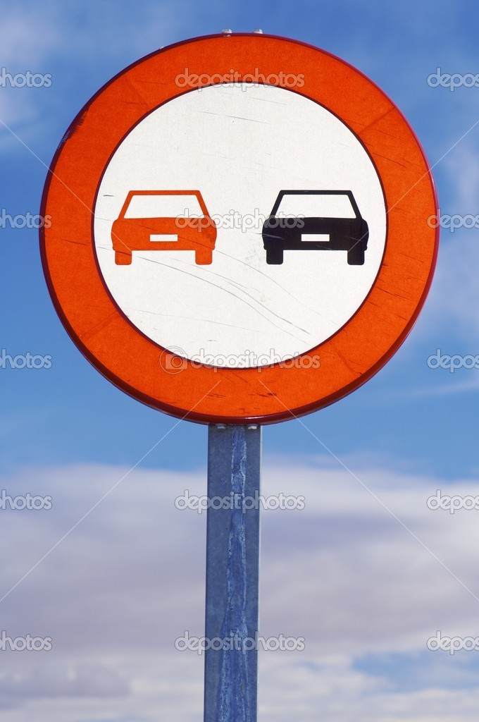 European prohibited overtaking sign on the road ahead  Stock Photo #9723414
