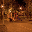 Child's Playground at Night - Stock Photo
