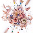 Multi-coloured pencil with crayon shavings - Stockfoto