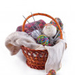 Balls of wool and knitting in basket - Stockfoto