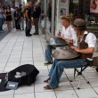 STOCKHOLM, SWEDEN.  AUGUST 21, 2011. Buskers with hangs - Stock Photo