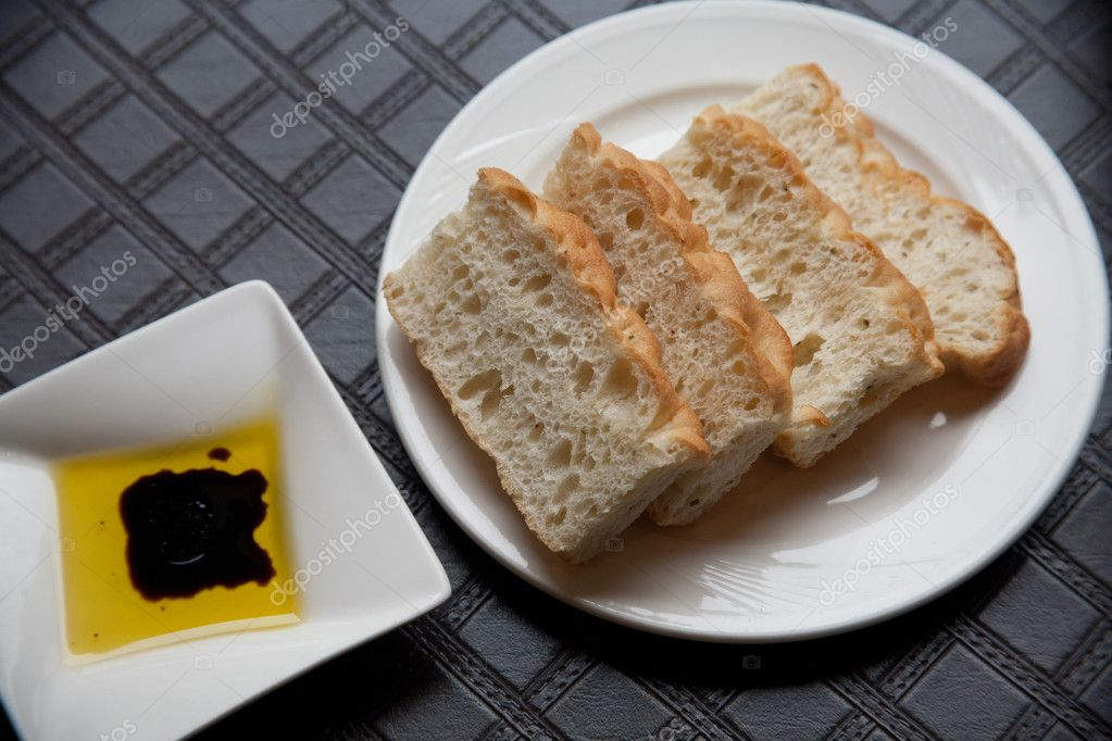 Bread with source on plate — Stock Photo #8791961