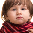 Boy wrapped in bright scarf on white background — Stock Photo #7980775