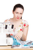 Woman in summer blouse darning on the sewing machine — Foto Stock