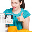 Girl in a blue dress on the sewing machine darning — 图库照片