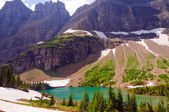 Rugged crags above an Alpine Lake — Stock Photo