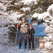 Couple our skiing with their dog — Stock Photo