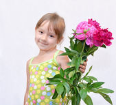 Child and flowerses — Stock Photo