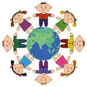 Children standing around Earth — Stock Photo