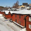 Red wooden houses on the river coast in Porvoo, Finland — Stock Photo #10030657
