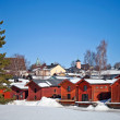 Red wooden houses on the river coast in Porvoo, Finland — Stock Photo #10030659