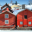 red wooden houses on the river coast in porvoo, finland — Stock Photo