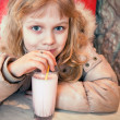Little girl with milk shake — Stock Photo