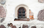 Old white stone wall with window — Stock Photo
