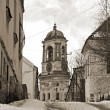 Stock Photo: Street with tower in Vyborg. Vintage stylized photo.
