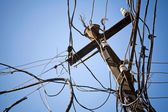 Chaotic wiring on an electric pillar — Stock Photo