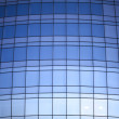Office building wall made of mirrored blue glass — Stock Photo #10537252