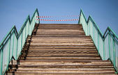 Footsteps and prohibiting red and white tapes — Stock Photo