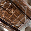 Inner construction of wooden roof it tower of ancient fortress - Stock Photo