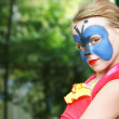 Portrait of a blond little girl with painted mask — Stockfoto