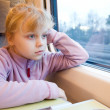 Little girl as a passenger of high speed train — Stockfoto