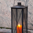 Stock Photo: Black metal vintage lamp with red candle inside