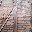 Street railway point on cobblestone road — Stock Photo