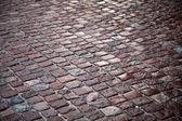 Texture of granite cobblestone road — Stock Photo