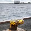 Old rusted yellow mooring bollard — Stock Photo