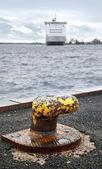 Old rusted yellow mooring bollard — Stock Photo