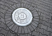 White sewer manhole marked with B — Stock Photo