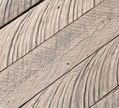 Texture of rough uncolored wooden lining boards — Stock Photo