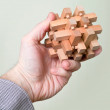 Puzzle in a man's hand - Stock Photo