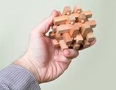 Puzzle in a man's hand — ストック写真